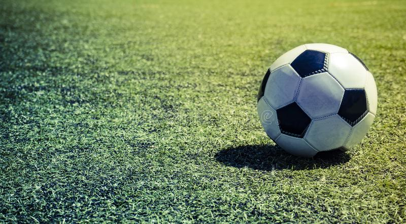 Soccer ball on green lawn. summers day.  stock image