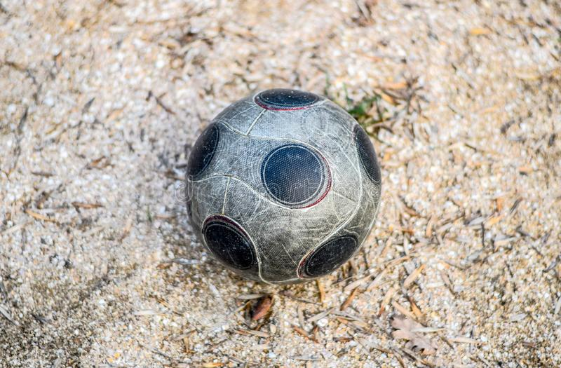 Soccer ball on the ground. The ball is for the games of the. Yard royalty free stock photos