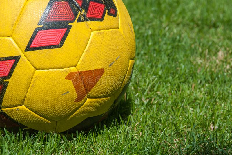 Soccer ball on ground. In the grass.  royalty free stock photography