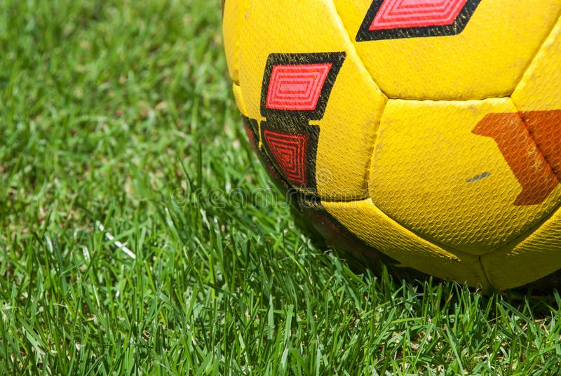 Soccer ball on ground. In the grass.  royalty free stock image