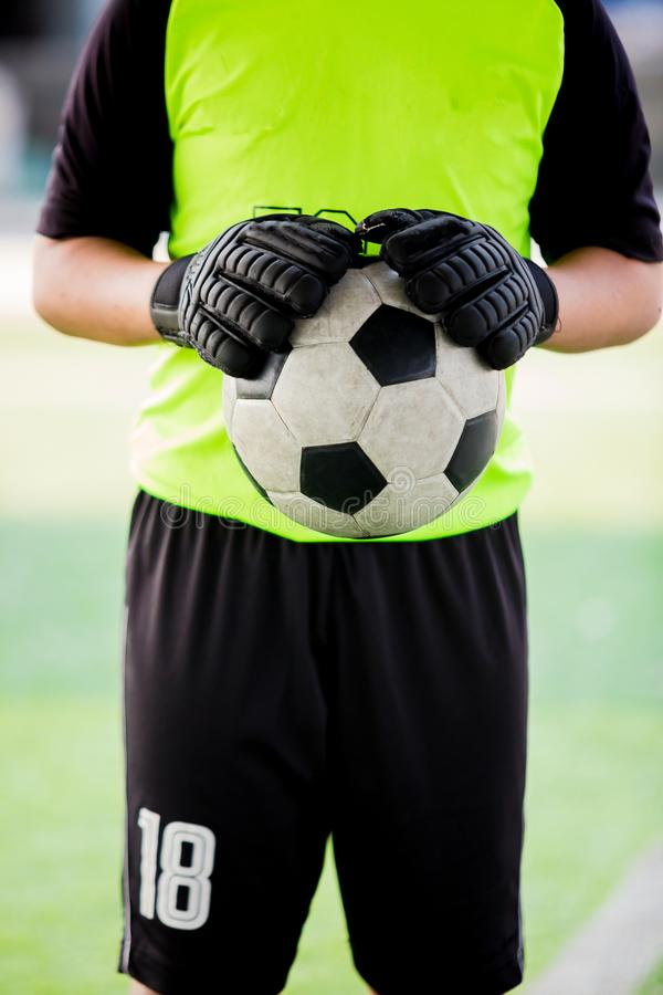 Soccer ball in hands of goalkeeper. Soccer player training. Or football match stock images