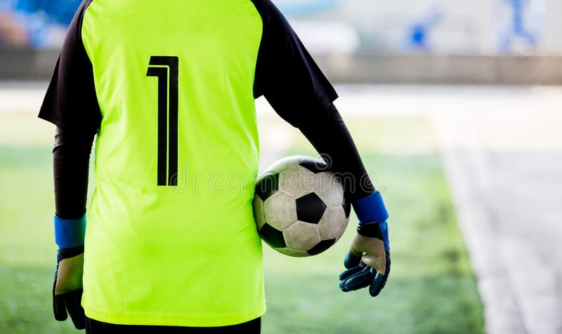 Soccer ball in hands of goalkeeper. Soccer player training. Or football match royalty free stock photos