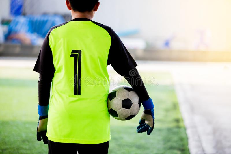 Soccer ball in hands of goalkeeper. Soccer player training. Or football match royalty free stock photo