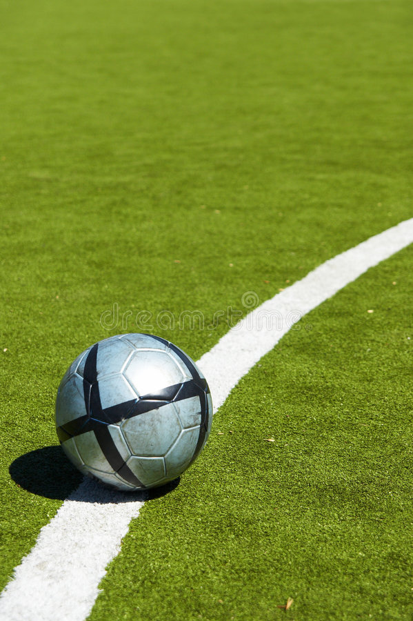 Soccer ball on a line royalty free stock photography