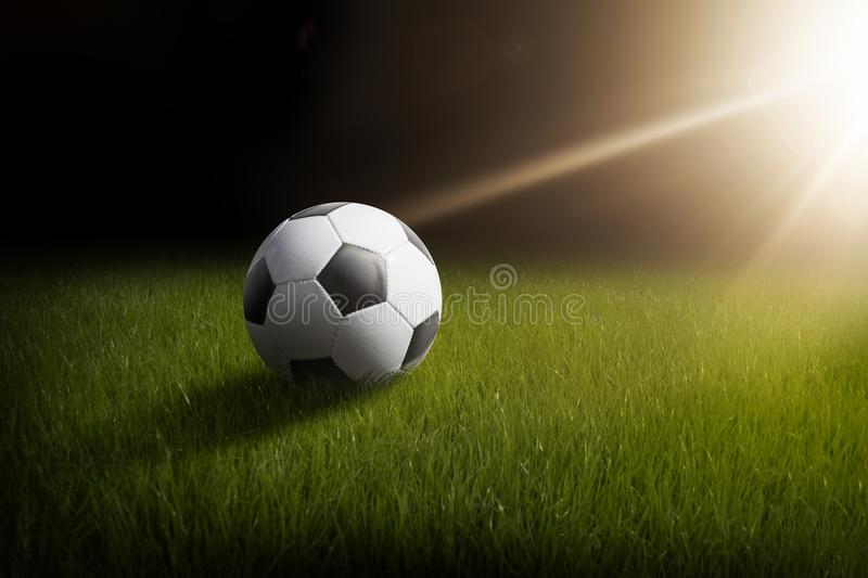 Soccer ball in night royalty free stock photography
