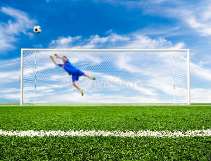 Soccer ball out of goal stock image