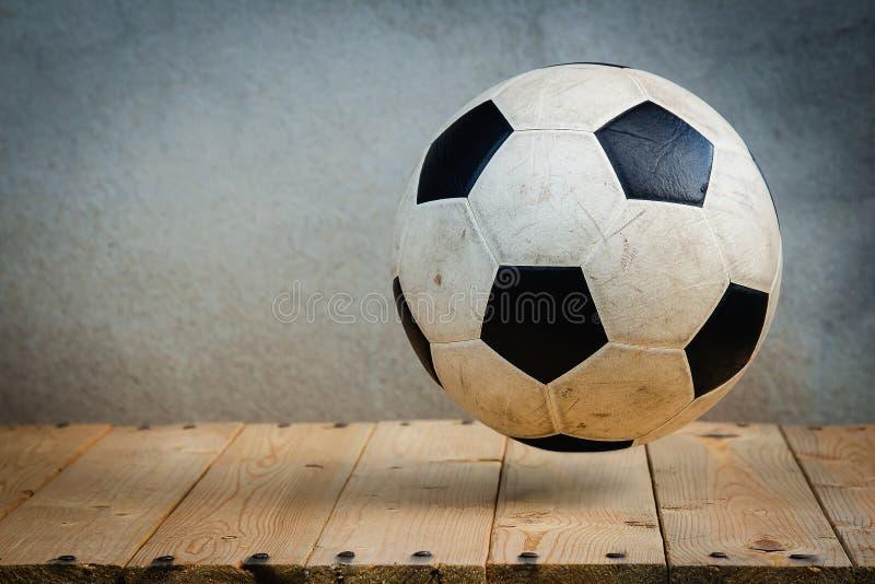 Soccer ball over wooden boards stock photos