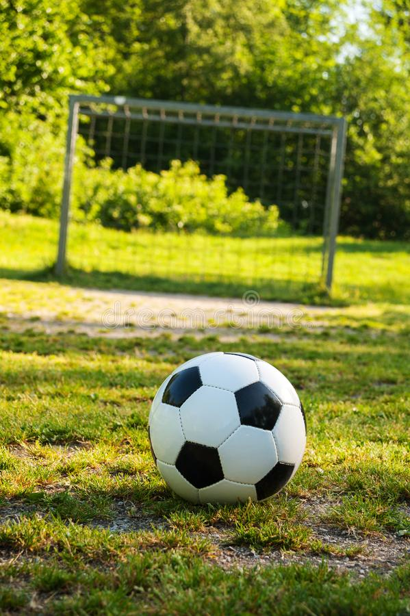Soccer ball on penalty spot in natural football ground. For the youth, football for kids, friends meeting on weekend fun stock photos