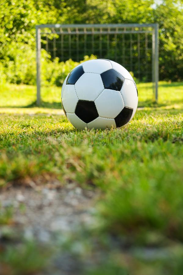 Soccer ball on penalty spot in natural football ground. For the youth, football for kids, friends meeting on weekend fun royalty free stock photos