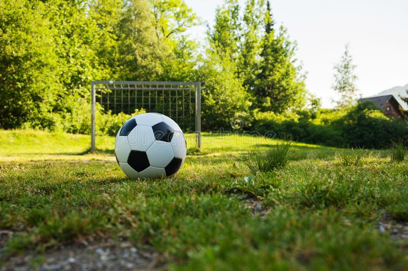 Soccer ball on penalty spot in natural football ground. For the youth, football for kids, friends meeting on weekend fun royalty free stock images