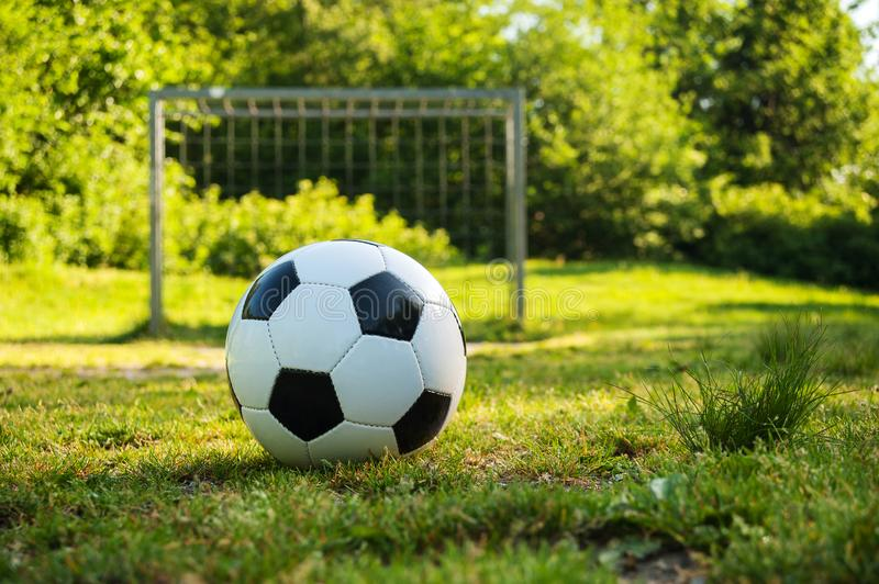 Soccer ball on penalty spot in natural football ground. For the youth, football for kids, friends meeting on weekend fun royalty free stock image