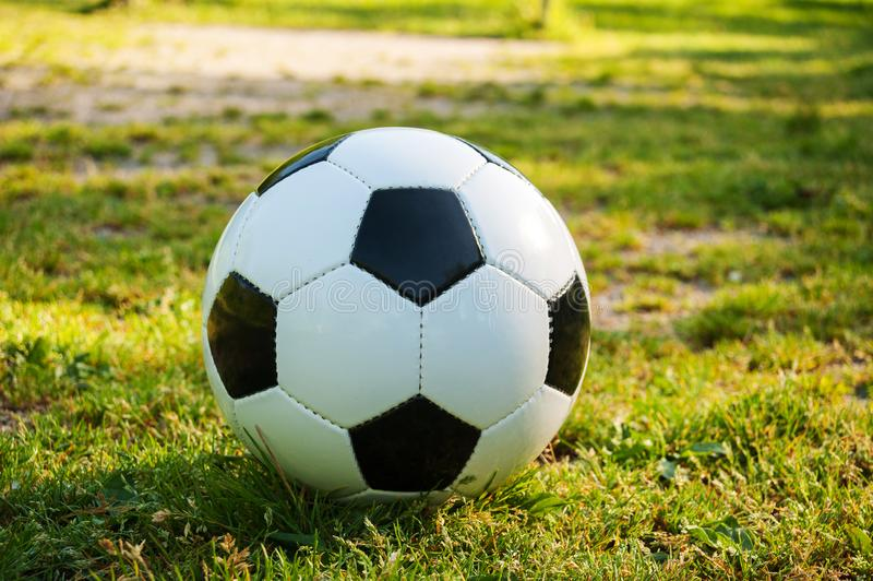 Soccer ball on penalty spot in natural football ground. For the youth, football for kids, friends meeting on weekend fun stock image