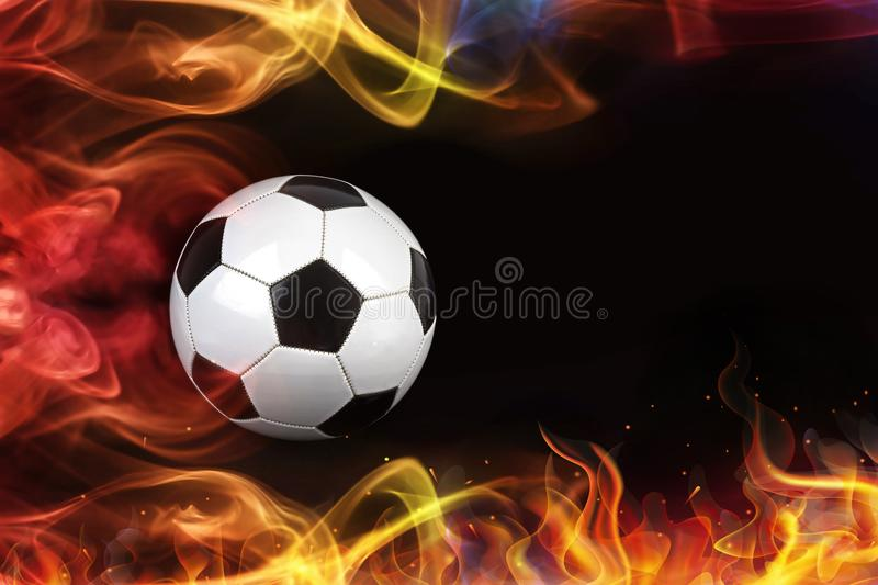 Soccer ball. Soccer ball with stadium lights and flames stock photography