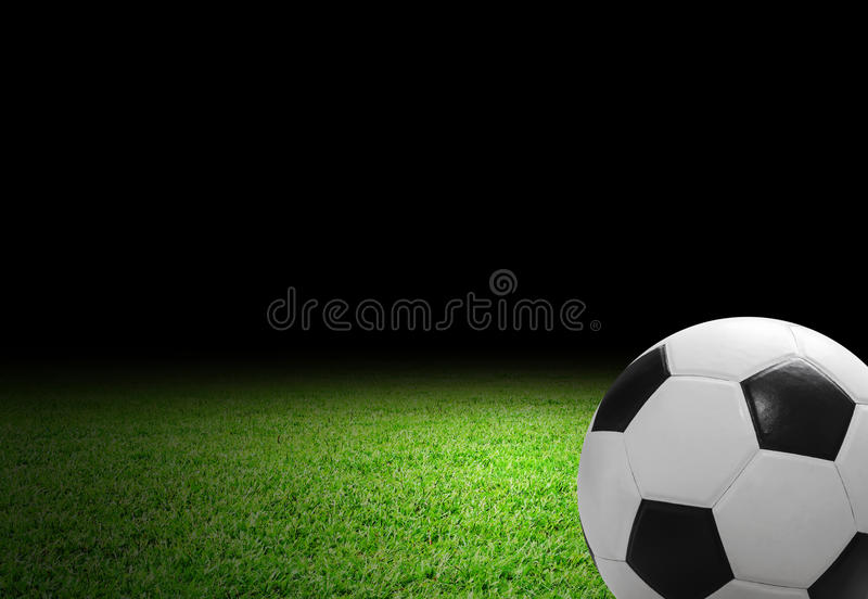Soccer ball on the soccer field. With copy space royalty free stock images
