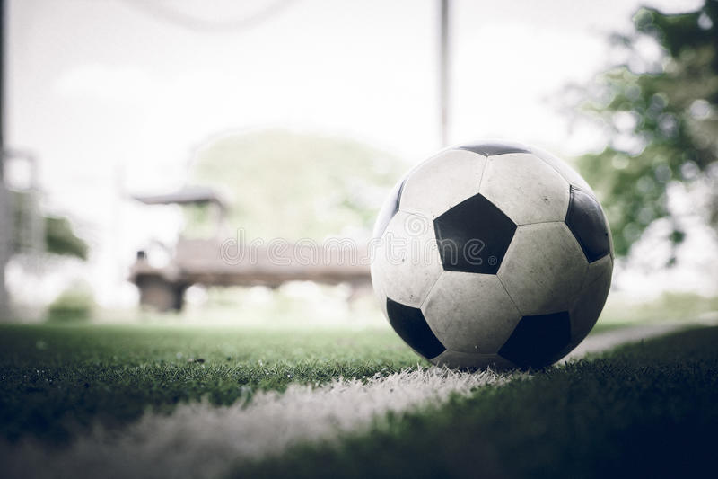 Soccer ball on soccer field vintage color royalty free stock photos