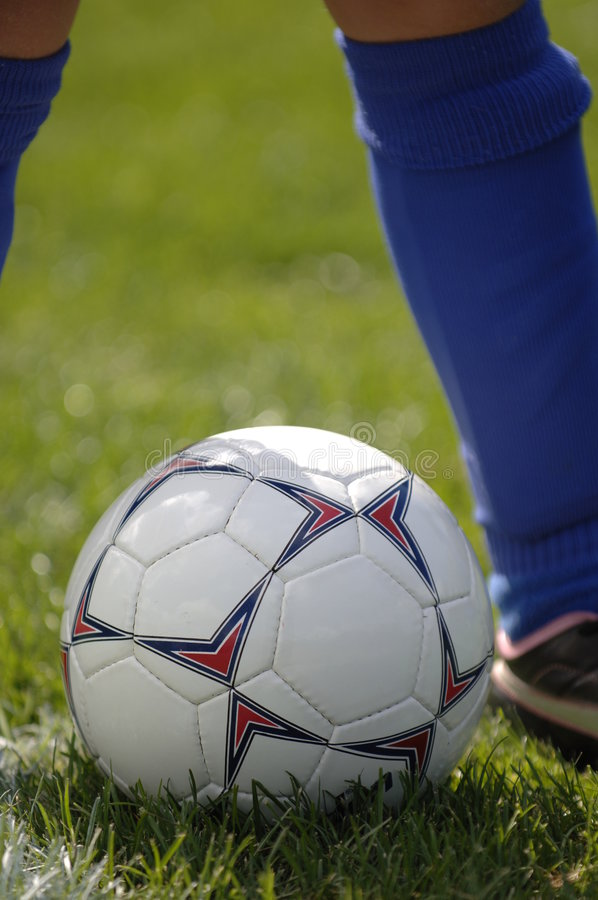 Soccer ball and soccer player 4 royalty free stock image