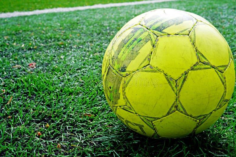 Ball on green grass of stadium. Soccer Football on white line of Soccer field background. stock images