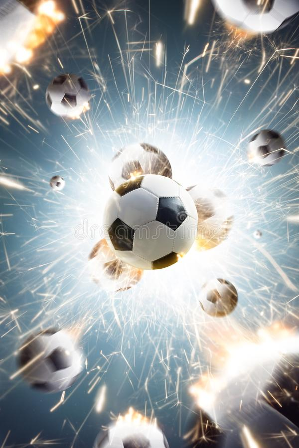 Soccer balls with fire sparks in action stock image