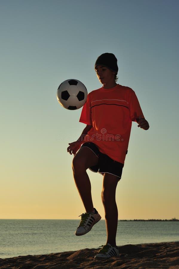Soccer On Beach Stock Photo