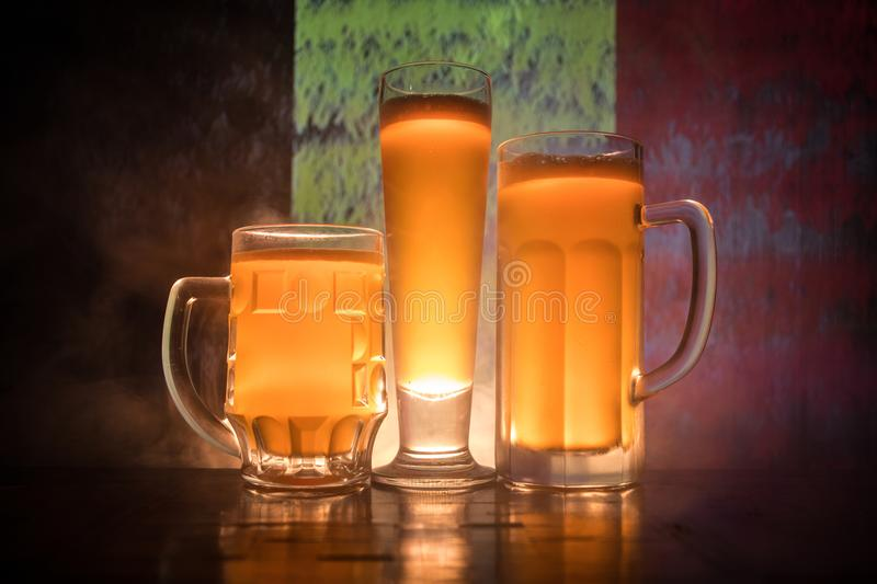 Soccer 2018. Beer glasses on table at dark toned foggy background. Support Belgium with beer concept. stock image