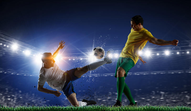 Soccer best moments. Mixed media . Mixed media. Soccer players at sport stadium fighting for ball . Mixed media stock photos