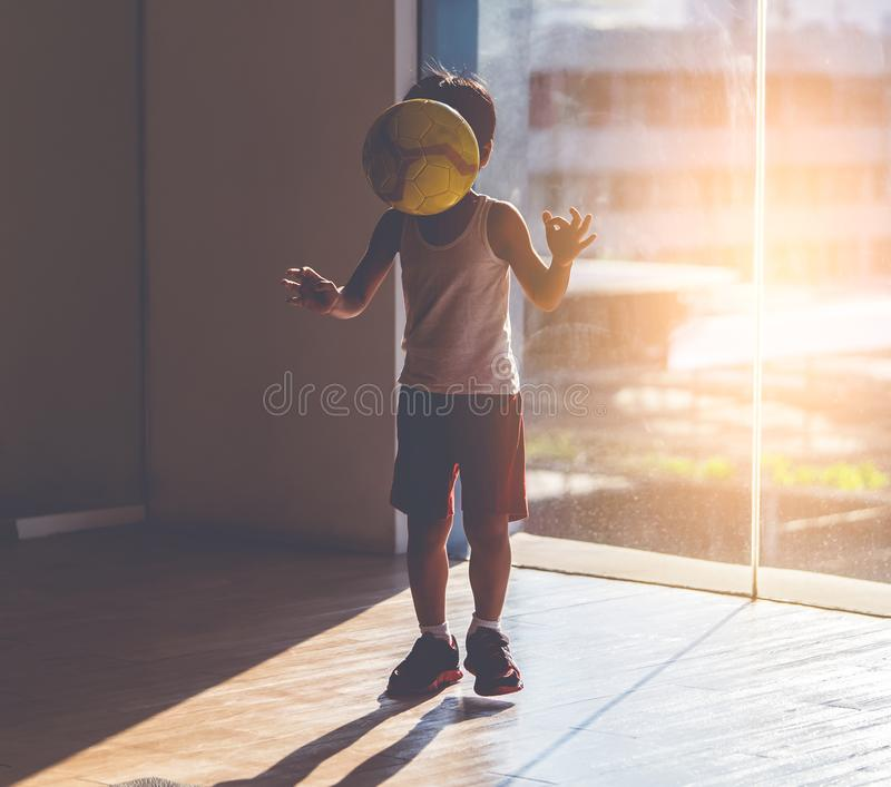 Soccer boy practice dribbling soccer in a room. Soccer boy practice dribbling soccer ball in a room stock photos