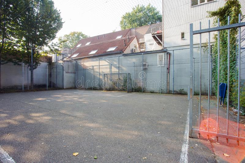 Soccer cage in the city, iron gate protection grid with soccer court behind it, empty. Soccer goal royalty free stock photography
