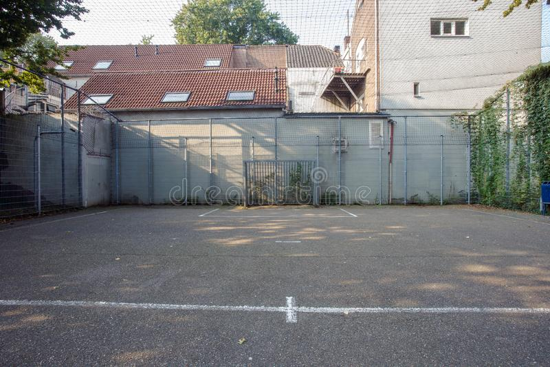 Soccer cage in the city, iron gate protection grid with soccer court behind it, empty. Soccer goal stock images