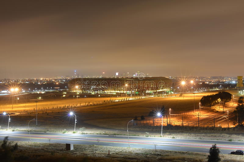 Soccer City - FNB Stadium Johannesburg at Night. FNB Stadium, also known as Soccer City, is a stadium located in Nasrec, the Soweto area of Johannesburg, South stock image