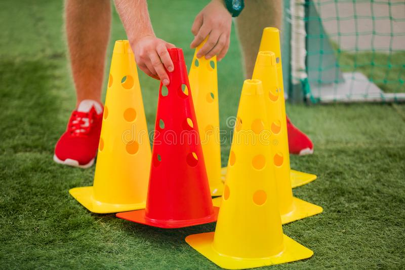 Soccer Coach Preparing Training Cones..Agility, Fitness and Power Training Equipment for Football Players royalty free stock images
