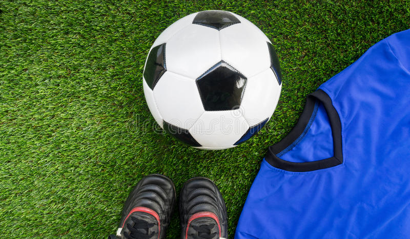 Soccer concept : Football & x28;soccer ball& x29;, old soccer boots, blue stock photo