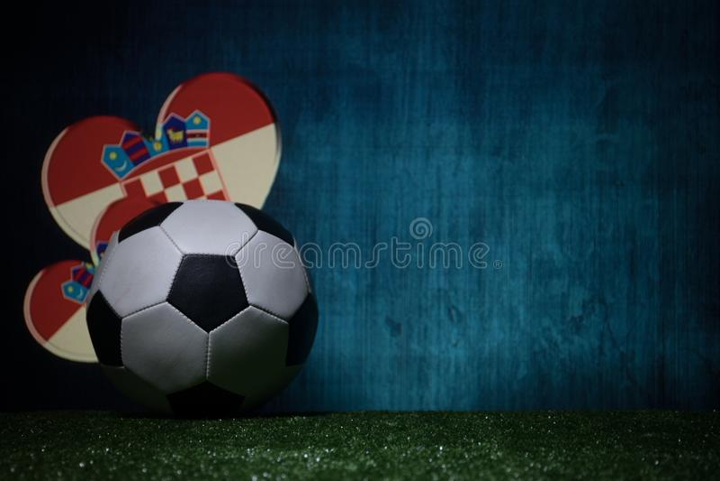 Soccer 2018. Creative concept. Soccer ball on green grass. Support Croatia team concept. Selective focus stock photo