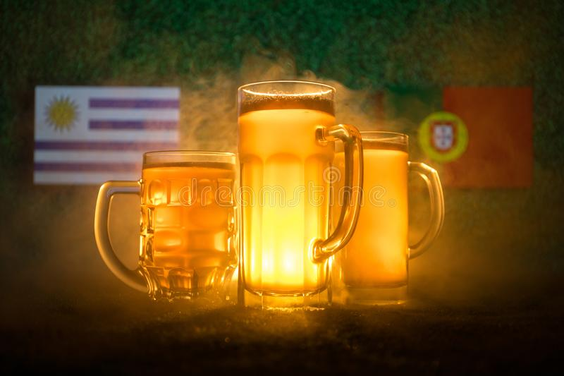 Soccer 2018. Creative concept. Beer glasses on grass. Support your country with beer concept. stock photos