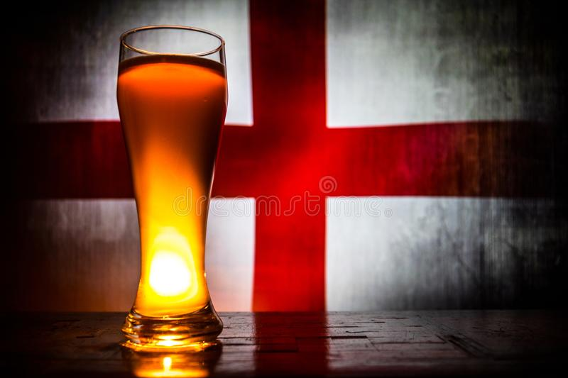 Soccer 2018. Creative concept. Single beer glass with beer on table ready to drink. Support your country with beer concept. stock image