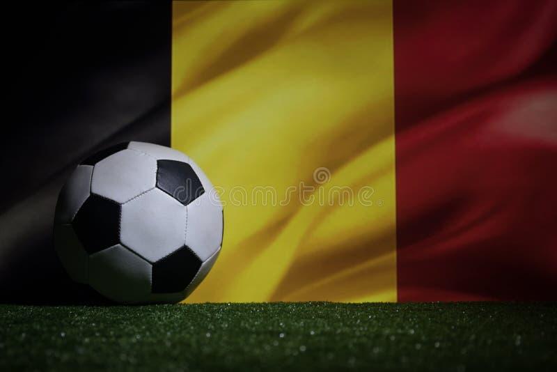 Soccer 2018. Creative concept. Soccer ball on green grass. Support Belgium team concept. Selective focus stock images