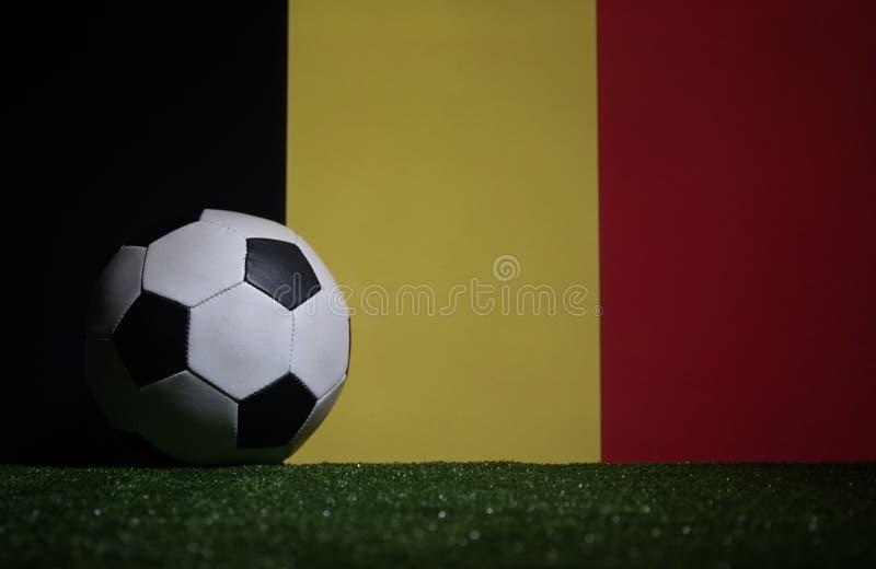 Soccer 2018. Creative concept. Soccer ball on green grass. Support Belgium team concept. Selective focus stock photography
