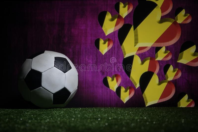 Soccer 2018. Creative concept. Soccer ball on green grass. Support Belgium team concept. Selective focus royalty free stock photo