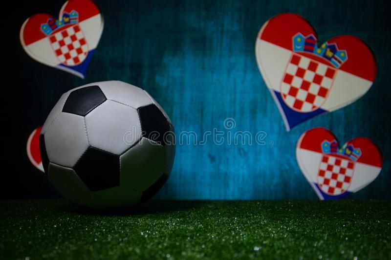 Soccer 2018. Creative concept. Soccer ball on green grass. Support Croatia team concept. Selective focus royalty free stock images