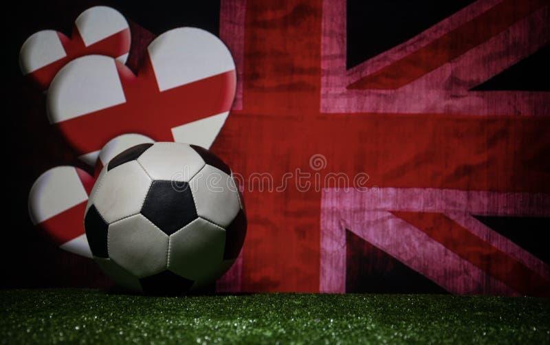 Soccer 2018. Creative concept. Soccer ball on green grass. Support England team concept. Selective focus royalty free stock photography
