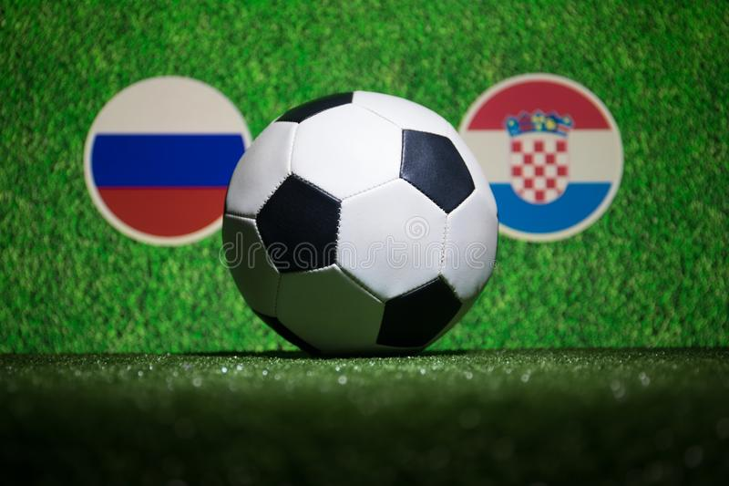 Soccer 2018. Creative concept. Soccer ball on green grass. Support your country or cheer concept. stock photography