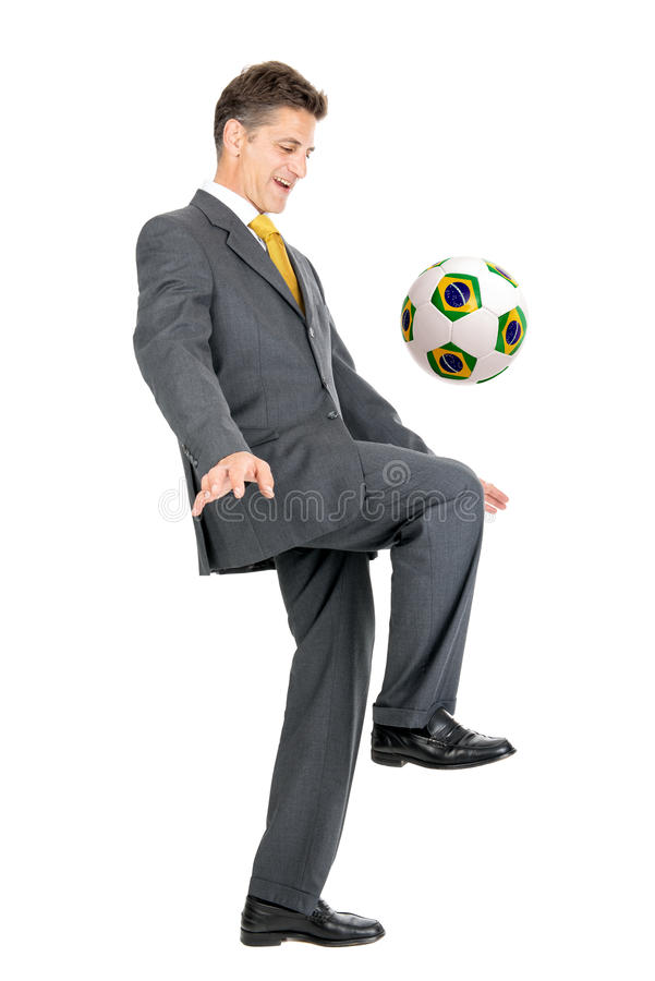 Soccer Cup. Businessman with Brazilian flag soccer ball isolated in white stock photos