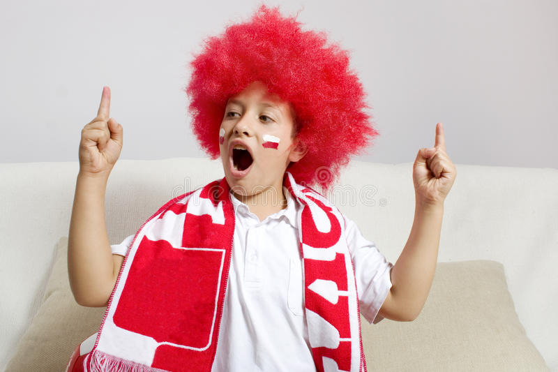 Soccer fan. Wearing red wig royalty free stock photos