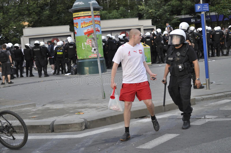 Soccer fan and riot police royalty free stock images