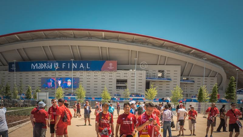 Soccer fans are walking in front if Wanda Metropolitano Stadium in Madrid, Spain royalty free stock image