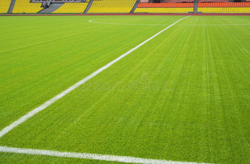 Soccer field. View of the green grassy artificial lawn on football/soccer field royalty free stock images