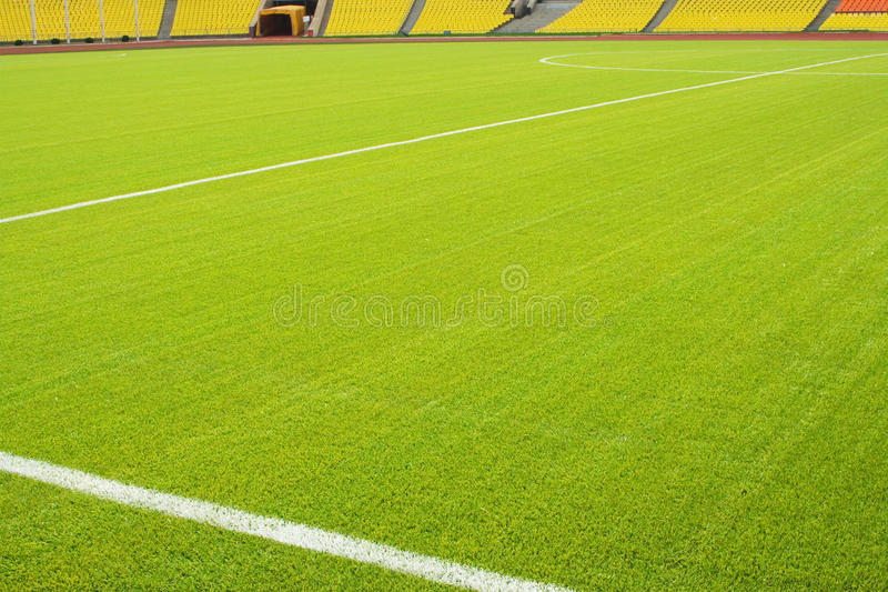 Soccer field. View of the green grassy artificial lawn on football/soccer field stock images