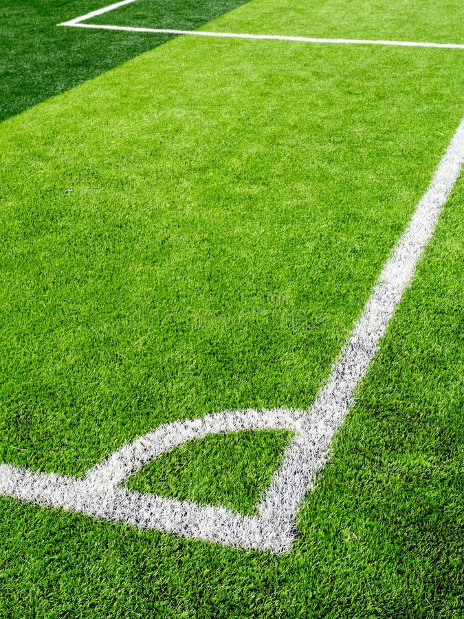 Soccer field, corner side, made from synthetic lawn. Selective focus stock photography