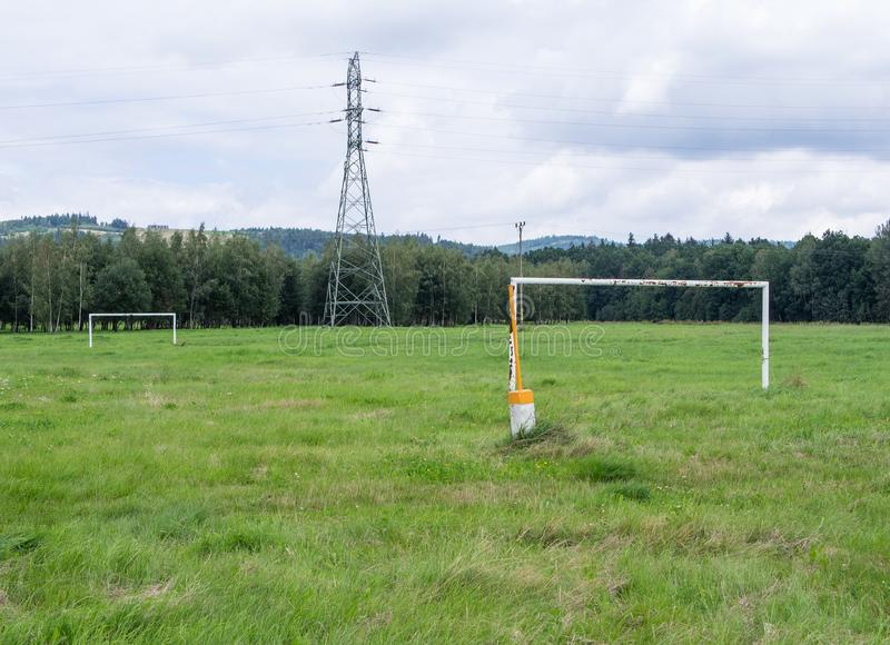 Soccer Field In Front of Power Pole, Forest And Hills, Jelenia Gora, Poland stock photos