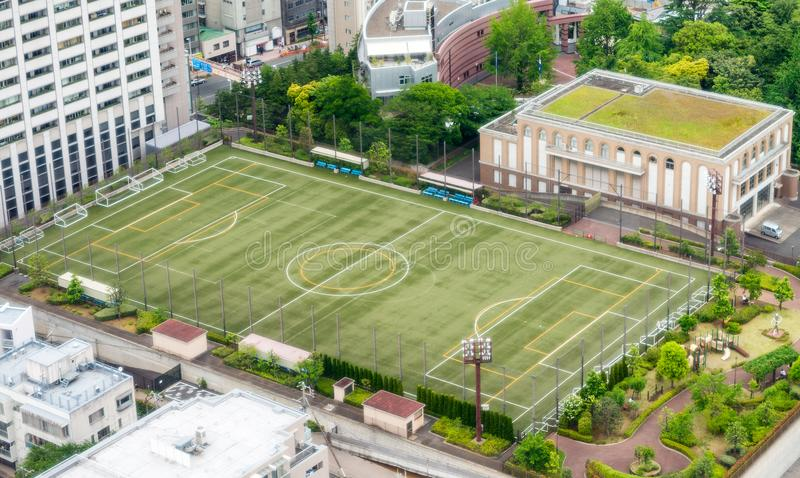 Soccer field in the middle of city buildings. Recreation concept.  royalty free stock photography