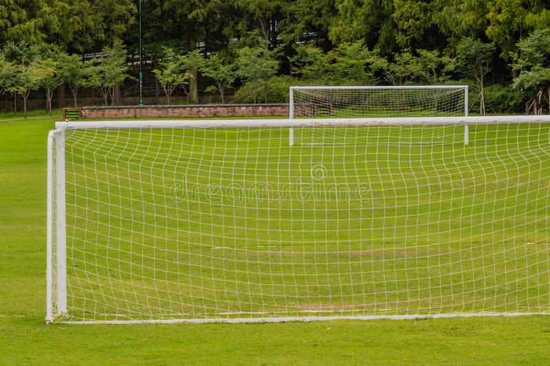 Soccer field with one goal in the foreground and one in the background stock image